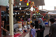 Iraqis enjoy a thriving central market place in the center of the Amil neighborhood in Southwest Baghdad August 23, 2010. Through an increase in Iraqi security force checkpoints and gated communities, Iraqis have enjoyed a vast improvement in terms of security over the past two years in areas like Amil, which previously had been sectarian battlefields with Iraqis forced to remain inside their homes for protection.   .