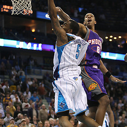 Feb 01, 2010; New Orleans, LA, USA; New Orleans Hornets guard Marcus Thornton (5) drives to the basket for a score past Phoenix Suns center Channing Frye (8) during the second half at the New Orleans Arena.The Suns defeated the Hornets 109-100. Mandatory Credit: Derick E. Hingle-US PRESSWIRE