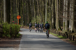 Cylance Pro Cycling through the woods.