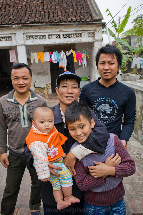 Rice farmer Nguyen Van Theo in Tho Quang rural village outside Hanoi, Vietnam with his sons and grandchildren. (Nguyen Van Theo is featured in the book What I Eat: Around the World in 80 Diets.) MODEL RELEASED.