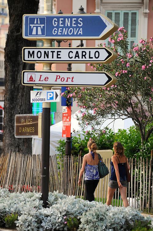 General view of two women walking down the street in Monaco, Monte Carlo.