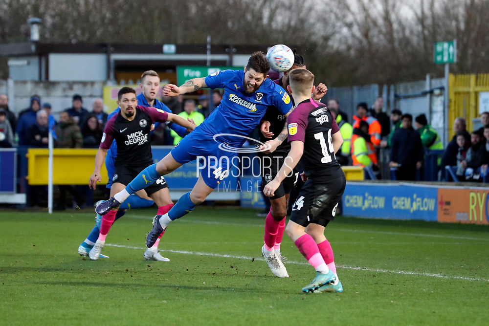 AFC Wimbledon midfielder Anthony Wordsworth (40) with a diving header in the box during the EFL Sky Bet League 1 match between AFC Wimbledon and Peterborough United at the Cherry Red Records Stadium, Kingston, England on 18 January 2020.