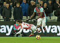Football - 2016 / 2017 Premier League - West Ham United vs. Stoke City<br /> <br /> Cheikhou Kouyate of West Ham knocks Bojan Krkic of Stoke City off the ball at The London Stadium.<br /> <br /> COLORSPORT/DANIEL BEARHAM