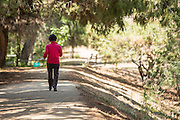 Woman Walking on Trail at Ralph B. Clark Regional Park in Buena Park
