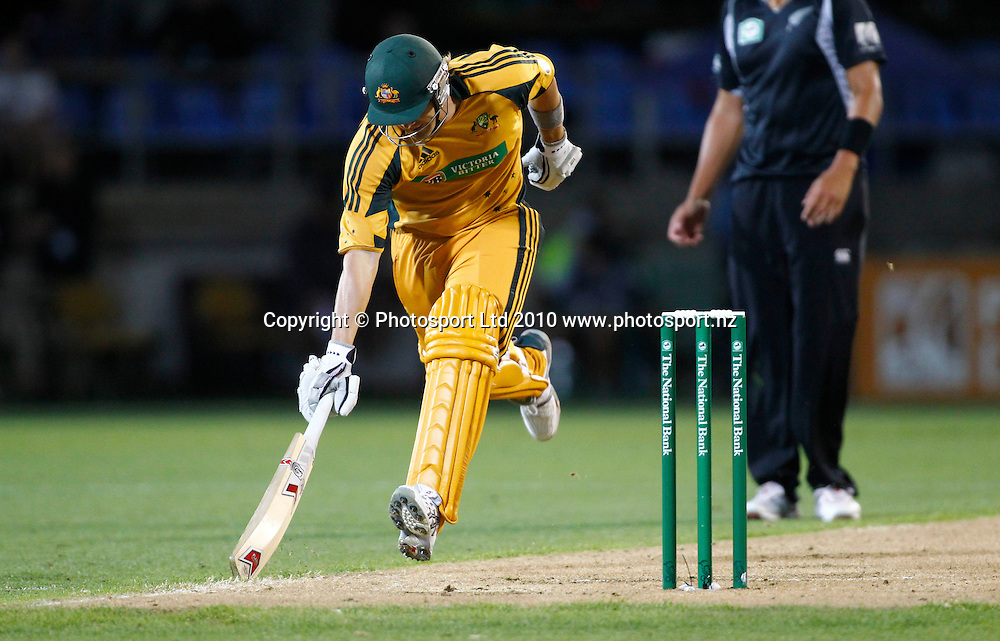Australian batsman Shane Watson slides his bat to make his ground. 4th one day international. New Zealand Black Caps versus Australia one day Chappell Hadlee cricket series. Eden Park, Auckland, New Zealand. Thursday 11 March 2010. Photo: Simon Watts/PHOTOSPORT