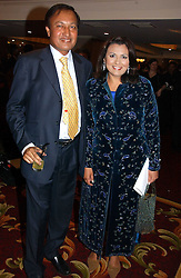 DR ALI and LISA AZIZ Sky news anchor woman at the 10th Anniversary Asian Business Awards 2006 at the London Grosvenor Hotel Park Lane, London on 19th April 2006.<br />