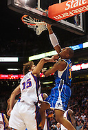 Mar. 14 2010; Phoenix, AZ, USA; New Orleans Hornets forward Julian Wright (32) puts up a shot against Phoenix Suns center Robin Lopez (15) in the first half at the US Airways Center. Mandatory Credit: Jennifer Stewart-US PRESSWIRE.