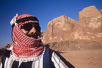 Arab Man in turban Wearing Sunglasses standing in desert landscape