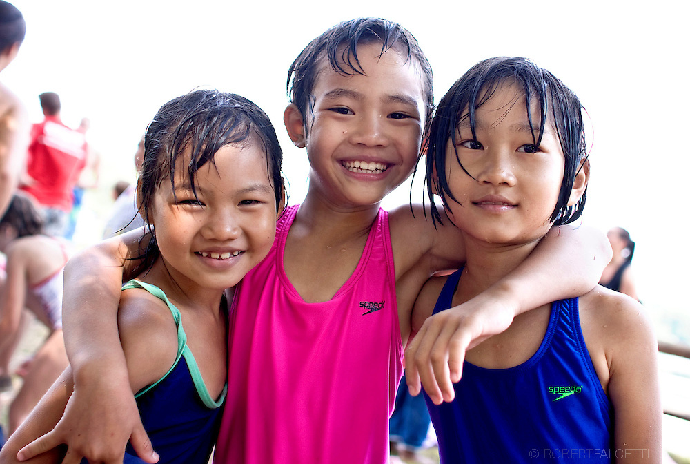 Karen refugees from left Riber Htoo,7; Eh Tha Boe,8, and Wa Ka Paw,7, said they enjoyed swimming while attendiing the YMCA's Camp Mataucha in Watertown. The children were able to attend because of the help of local volunteers such as Jo Ann Robertson of Watertown.  . (Photo by Robert Falcetti)