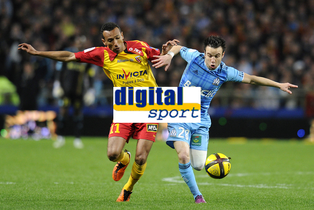FOOTBALL - FRENCH CHAMPIONSHIP 2010/2011 - L1 - RC LENS v OLYMPIQUE MARSEILLE - 3/04/2011 - PHOTO JEAN MARIE HERVIO / DPPI - MATHIEU VALBUENA (OM) / EDUARDO (RCL)