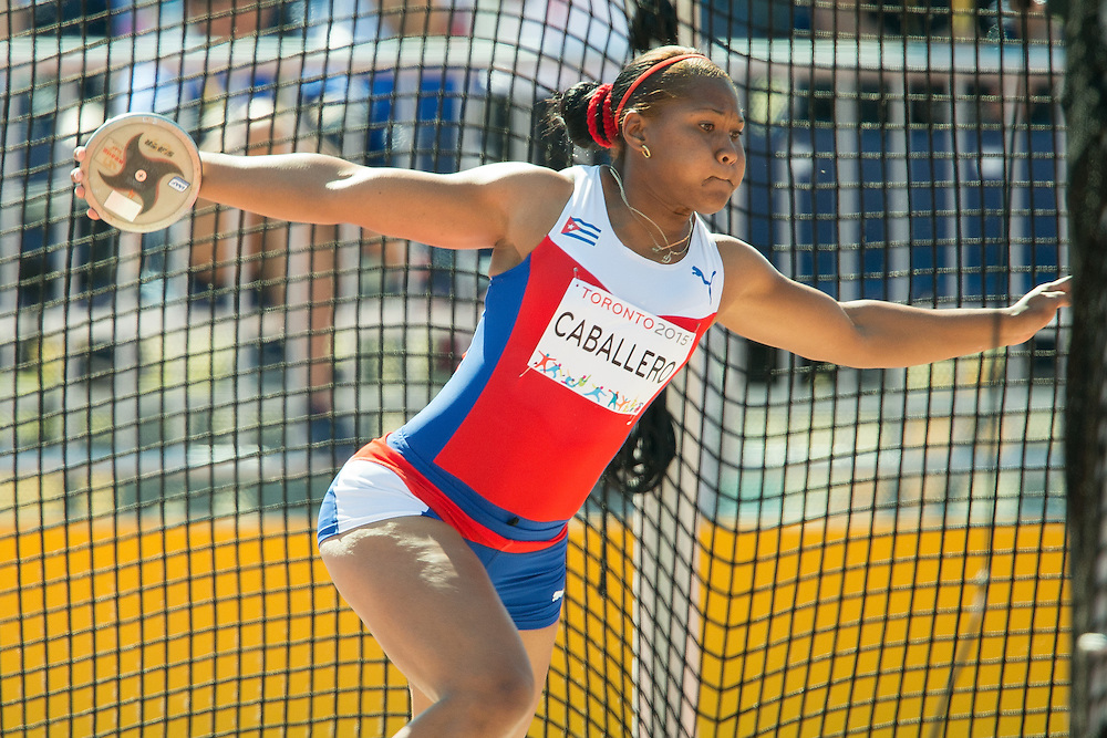 Denia Caballero  of Cuba throws the discus during the women's competition at CIBC Athletics Stadium at the 2015 Pan American Games in Toronto, Canada, July 24,  2015.  AFP PHOTO/GEOFF ROBINS