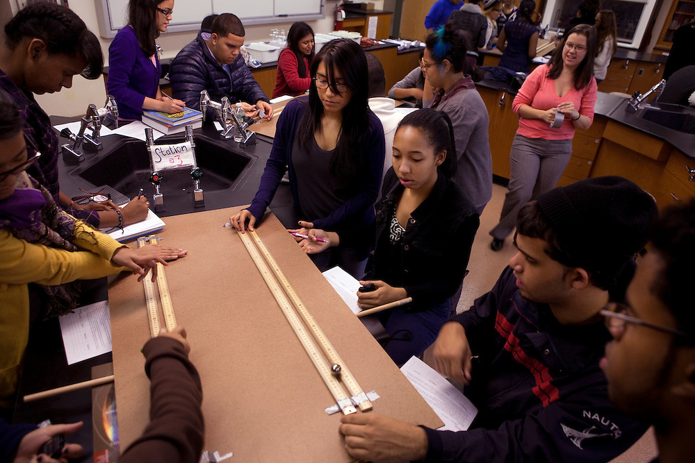 Elvira Quintero, 17, center, surrounded by students in 12th Grade Physics lab at Central Park East High School in New York, NY on November 15, 2012. Beyond sheer physical safety, a look at how schools and sitricts can create classroom conditions in which students are able to engage enthusiastically and without emotional fear of stepping forward. Photographer: Melanie Burford/Prime