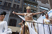 A transgendered participant in gold on the Translatinas of New York float.