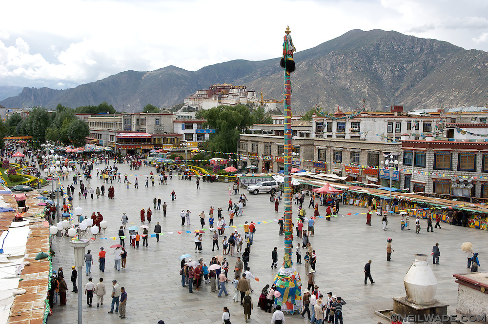 Barkor Square as seen from the roof of the Jokhang in Lhasa, Tibet.  The Potala Palace can be seen in the distance.