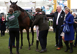 Harry Skelton (centre) celebrates with trainer Dan Skelton after the Randox Health County Handicap Hurdle during Gold Cup Day of the 2019 Cheltenham Festival at Cheltenham Racecourse.