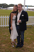 Joe Bamford and Michelle Adamson. Cartier International Day at Guards Polo Club, Windsor Great Park. July 24, 2005. ONE TIME USE ONLY - DO NOT ARCHIVE  © Copyright Photograph by Dafydd Jones 66 Stockwell Park Rd. London SW9 0DA Tel 020 7733 0108 www.dafjones.com