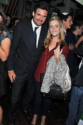 EDWARD TAYLOR and SAM MAGNIER daughter of John Magnier at a party to celebrate the opening of Bunga Bunga - a new Pizzeria & Bar, 37 Battersea Bridge Road, London SW11 on 1st September 2011.