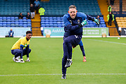 AFC Wimbledon goalkeeping coach Ashley Bayes warming up but appearing to dance warming up with AFC Wimbledon goalkeeper Nathan Trott (1) during the EFL Sky Bet League 1 match between Southend United and AFC Wimbledon at Roots Hall, Southend, England on 12 October 2019.