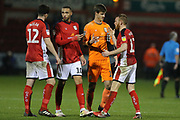 Crewe players congratulate each other after their 2-1 win during the EFL Sky Bet League 2 match between Crewe Alexandra and Lincoln City at Alexandra Stadium, Crewe, England on 26 December 2018.