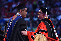 Chancellor Randy Woodson congratulates a graduate student on his degree.