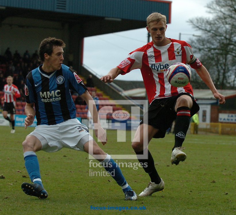 Rochdale - Saturday, March 28th, 2009:  Rochdale's Will Buckley and Exeter City's Dean Moxey during the Coca Cola League Two match at Rochdale. (Pic by John Rushworth/Focus Images)