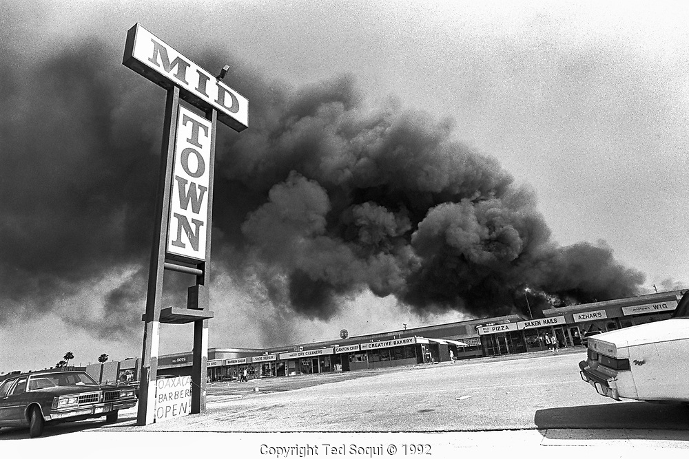 A shopping mall is burned and looted in the mid-city area of Los Angeles.<br /> <br /> 25 before and after LA92 photo project.