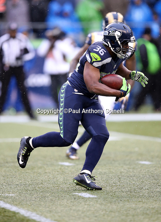 Seattle Seahawks running back Bryce Brown (36) runs the ball during the 2015 NFL week 16 regular season football game against the St. Louis Rams on Sunday, Dec. 27, 2015 in Seattle. The Rams won the game 23-17. (©Paul Anthony Spinelli)