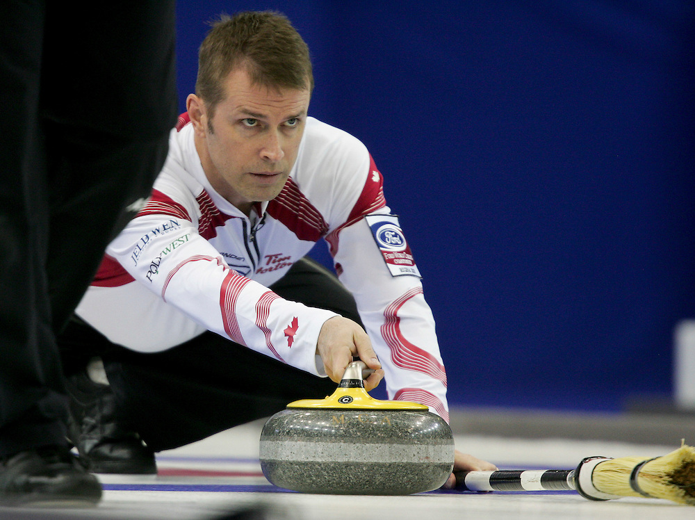Canadian skip Jeff Stoughton delivers his stone during Canada's 1-2 playoff match against Scotland at the Ford World Men's Curling Championships in Regina, Saskatchewan, April 8, 2011.<br /> AFP PHOTO/Geoff Robins