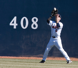 Virginia Cavaliers outfielder Tim Henry (6) grabs a Bucknell pop up.  The Virginia Cavaliers Baseball Team defeated the Bucknell University Bisons 3-0 in the first game of a doubleheader at Davenport Field in Charlottesville, VA on February 24, 2007.