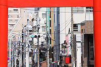 Electrical Lines and Street Light Seen Through Torii Gate