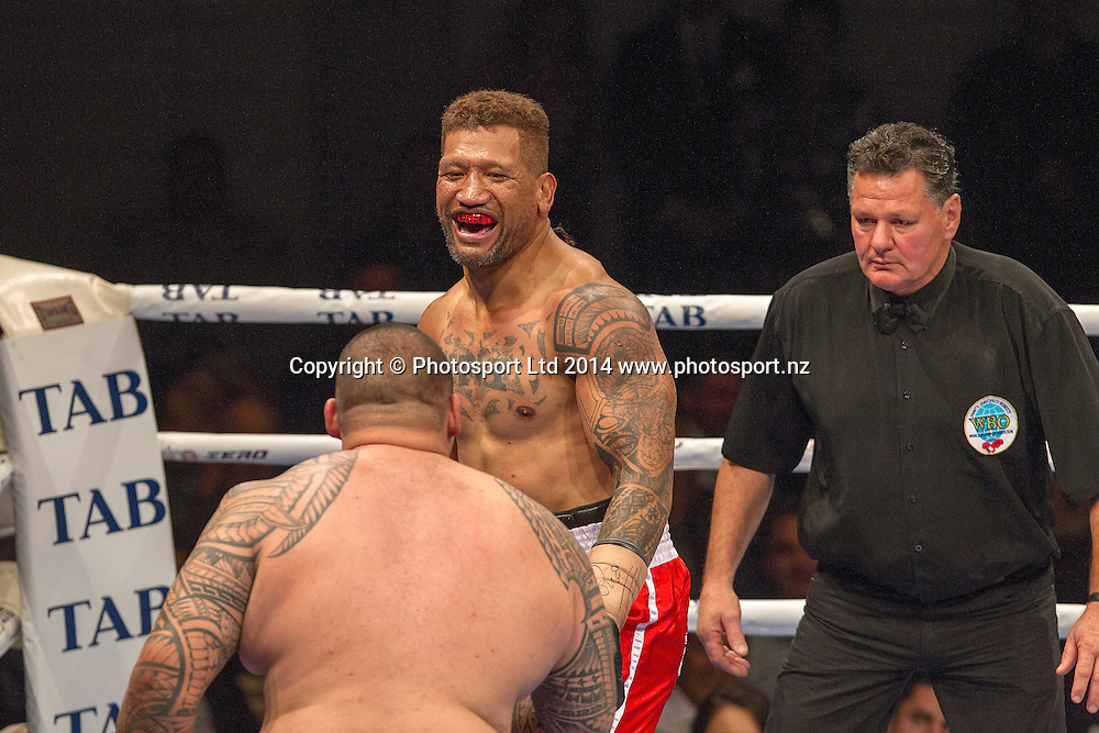 Lopini (MVPHorse) Vatuvei faces and laughs at Dave (Brown Buttabean) Letele during their fight at the Hydr8 Zero Heavyweight Explosion, Vodafone Events Centre, Auckland, New Zealand, Saturday, July 05, 2014. Photo: David Rowland/Photosport