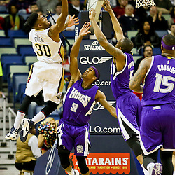 Jan 28, 2016; New Orleans, LA, USA; New Orleans Pelicans guard Norris Cole (30) shoots over Sacramento Kings guard Rajon Rondo (9) and guard James Anderson (5) during the first quarter of a game at the Smoothie King Center. Mandatory Credit: Derick E. Hingle-USA TODAY Sports