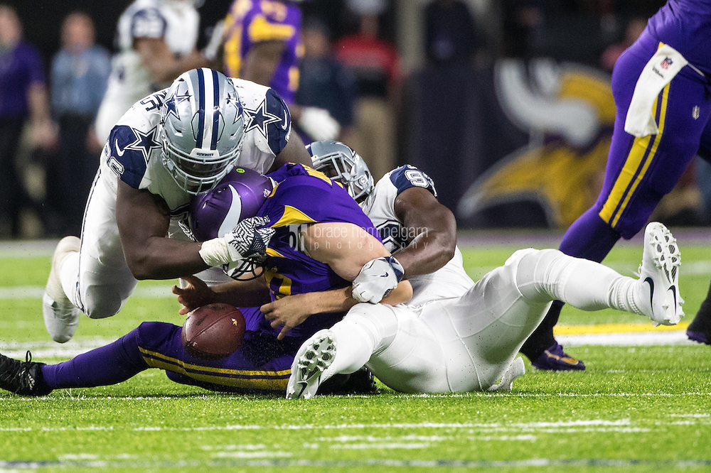 Dec 1, 2016; Minneapolis, MN, USA; Minnesota Vikings quarterback Sam Bradford (8) is sacked by Dallas Cowboys defensive end Benson Mayowa (93) and defensive tackle Maliek Collins (96) during the fourth quarter at U.S. Bank Stadium. The Cowboys defeated the Vikings 17-15. Mandatory Credit: Brace Hemmelgarn-USA TODAY Sports