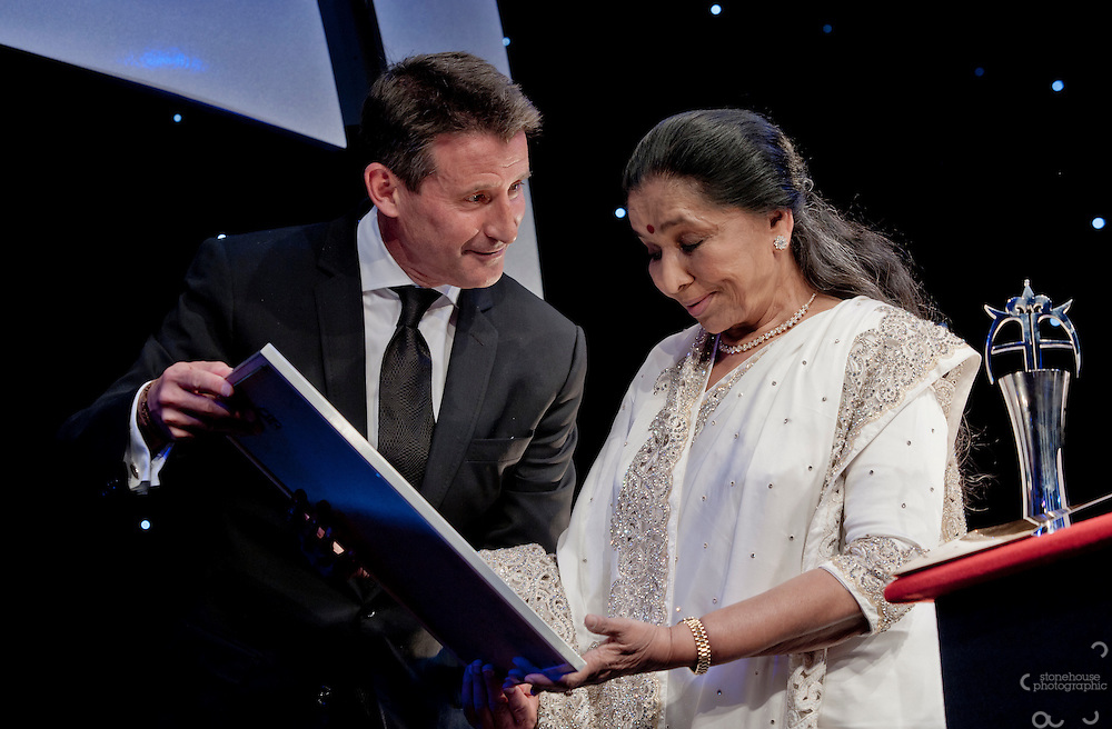 Lord Sebastian Coe presents Asha Bhosle with the Guinness world record for the most recorded artist award at The Asian Awards 2011 held at the Grosvenor House Hotel, London..The Asian Awards, which have been set up to celebrate the highest achievement from across the international Asian community. Awards are open to individuals born in or with direct family origin from India, Pakistan, Sri Lanka or Bangladesh.  ..The Asian Awards recognise and reward exemplary achievement across 11 categories that include business, philanthropy, entertainment, culture and sport. Nominees were selected by an independent judging panel consisting of key business people, cultural leaders and eminent political figures, chaired by Baroness Verma of Leicester.