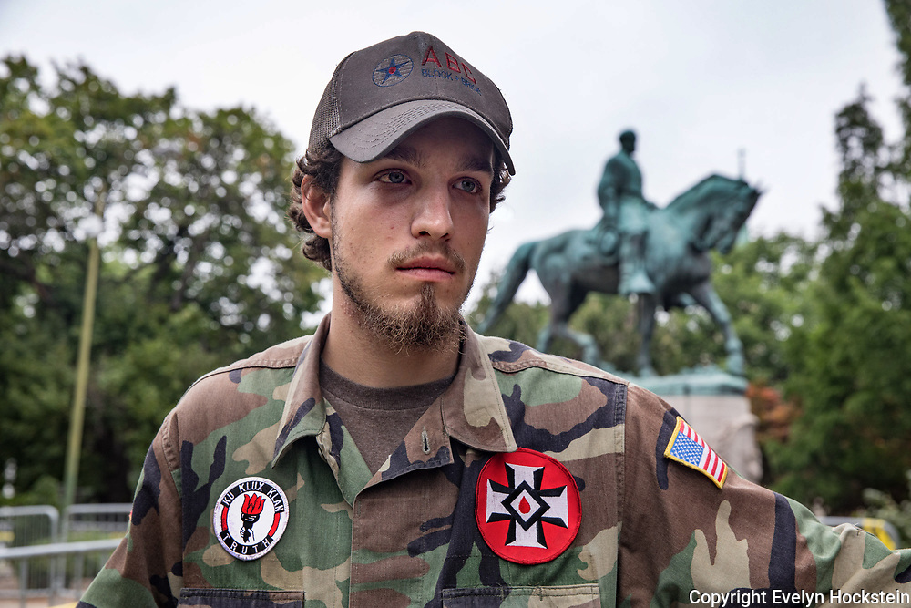 CHARLOTTESVILLE,VA-AUG12: Ben, a 21-year-old KKK member from Harrison, Arkansas, in Emancipation Park prior to the Unite the Right rally in Charlottesville,Virginia, August 12, 2017.(Photo by Evelyn Hockstein/For The Washington Post)