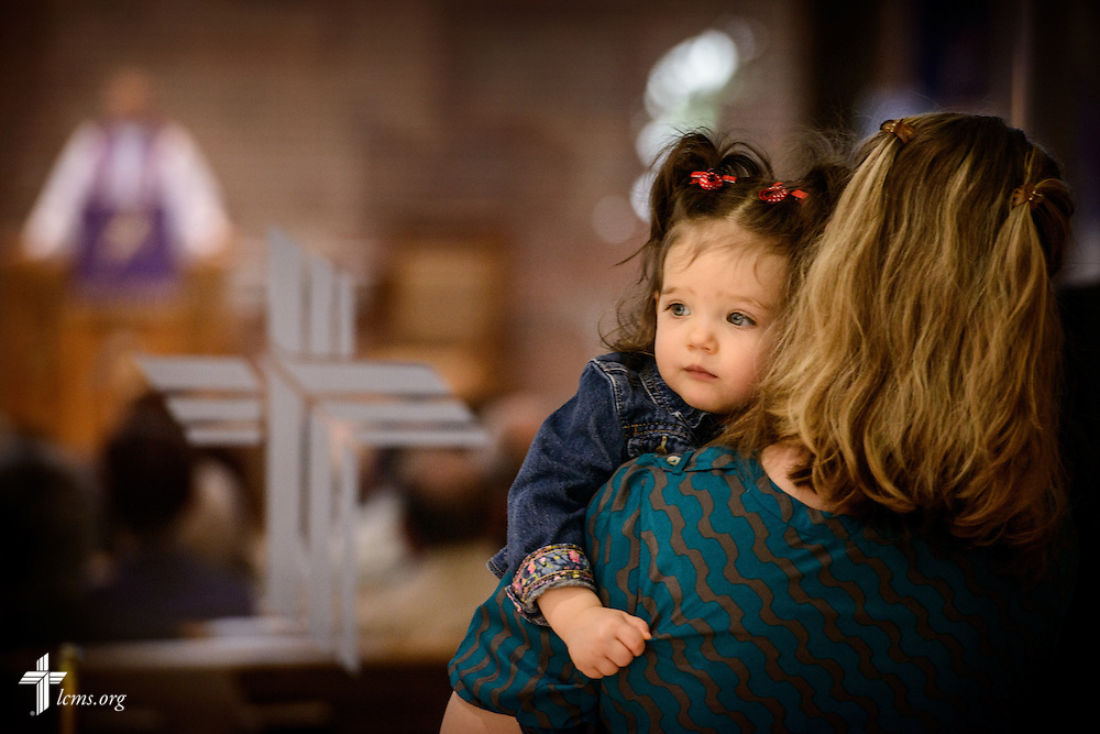 Madelyn Zokvic is held by her mother Elizabeth as they wait to reenter the sanctuary during worship at St. Luke's Lutheran Church on Sunday, March 6, 2016, in Oviedo, Fla. LCMS Communications/Erik M. Lunsford