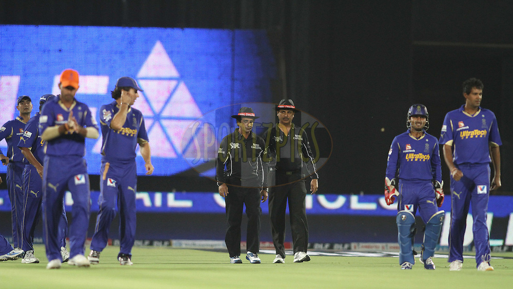 Umpire Asad Rauf and Sudhir Asnani lead the players out during match 30 of the the Indian Premier League (IPL) 2012  between The Rajasthan Royals and the Royal Challengers Bangalore held at the Sawai Mansingh Stadium in Jaipur on the 23rd April 2012..Photo by Shaun Roy/IPL/SPORTZPICS