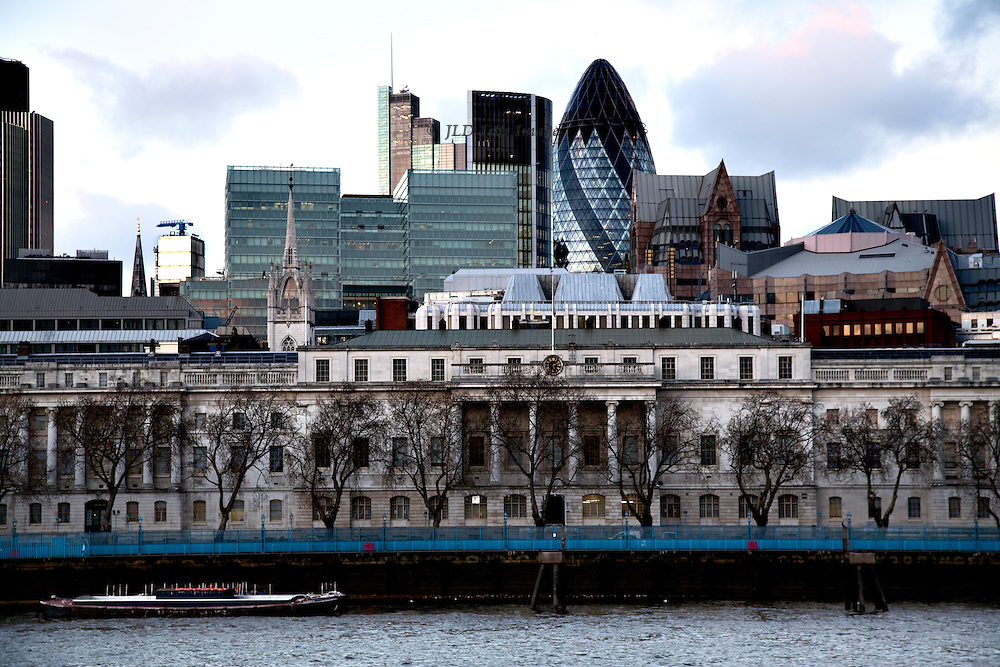 Telephoto view of The City of London from the South Bank of the Thames river.
