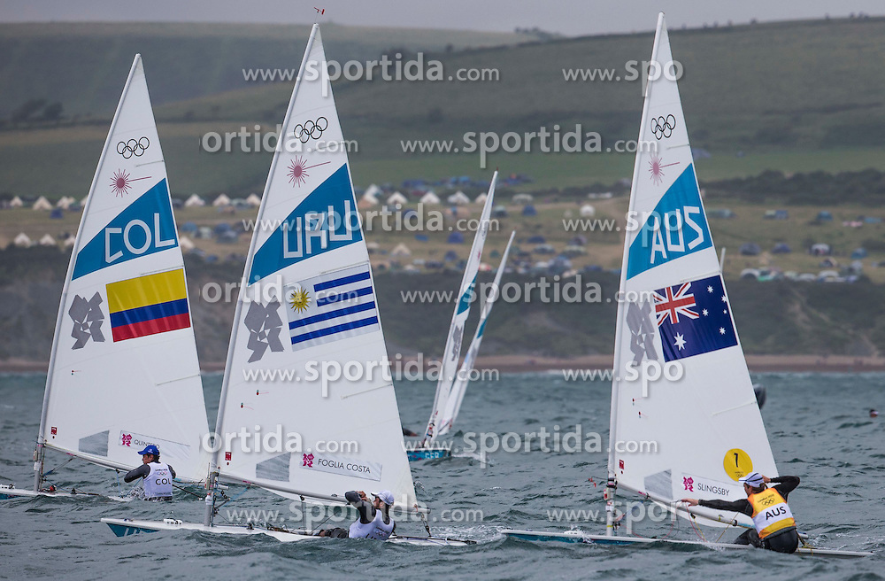 04.08.2012, Bucht von Weymouth, GBR, Olympia 2012, Segeln, im Bild Quintero Andrey, (COL, Laser).Foglia Alejandro, (URU, Laser).Slingsby Tom, (AUS, Laser) // during Sailing, at the 2012 Summer Olympics at Bay of Weymouth, United Kingdom on 2012/08/04. EXPA Pictures © 2012, PhotoCredit: EXPA/ Daniel Forster ***** ATTENTION for AUT, CRO, GER, FIN, NOR, NED, POL, SLO and SWE ONLY!
