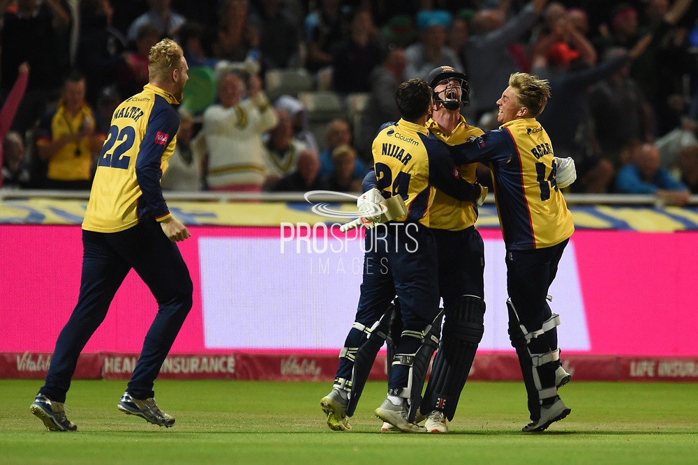 Simon Harmer of Essex Eagles is congratulated by Paul Walter, Aron Nijjar and Aaron Beard after hitting the winning runs during the Vitality T20 Finals Day 2019 match between Worcestershire County Cricket Club and Essex County Cricket Club at Edgbaston, Birmingham, United Kingdom on 21 September 2019.