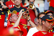 Belgium fan plays the trumpet to start a song during the Euro 2016 match between Sweden and Belgium at Stade de Nice, Nice, France on 22 June 2016. Photo by Andy Walter.