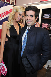 SOPHIE CROSS and FILIPPOS LEMOS at the launch party for the Vicomte A boutique in London at 113 King's Road, London SW3 on 13th December 2012.