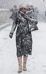 © Licensed to London News Pictures. 27/02/2018. London, UK. A woman wades through heavy snowfall on the Millennium Bridge near St Paul's Cathedral in the City of London, as a cold front, named the 'Beast From the East' hits the capital. Amber weather warnings are in place for large parts of the east of the UK as a severe cold front heads in from Russia. Photo credit: Ben Cawthra/LNP