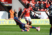 Romaine Sawyers is tackled by Mitchell Lund during the Sky Bet League 1 match between Walsall and Doncaster Rovers at the Banks's Stadium, Walsall, England on 12 September 2015. Photo by Alan Franklin.