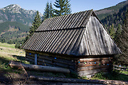 An traditional wooden agricultural hut on Polana Chocholowska a hiking route on Dolina Chocholowska in the Tatra National Park, on 17th September 2019, near Zakopane, Malopolska, Poland.