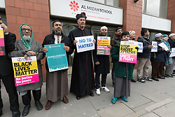 © Licensed to London News Pictures. 03/04/2018. London, UK. People from accross the east London community join muslims after evening prayers to take part in the national Happier Together Day by staging a demonstration in the street outside the East London Mosque in Whitechapel. The Happier Together campaign values Britain's rich cultural diversity and represents people who want to live in a country that embraces ethnic, cultural and religious difference, rejecting discrimination and hatred in all forms with a vision of strong, united communities based on what we have in common. Photo credit: Vickie Flores/LNP