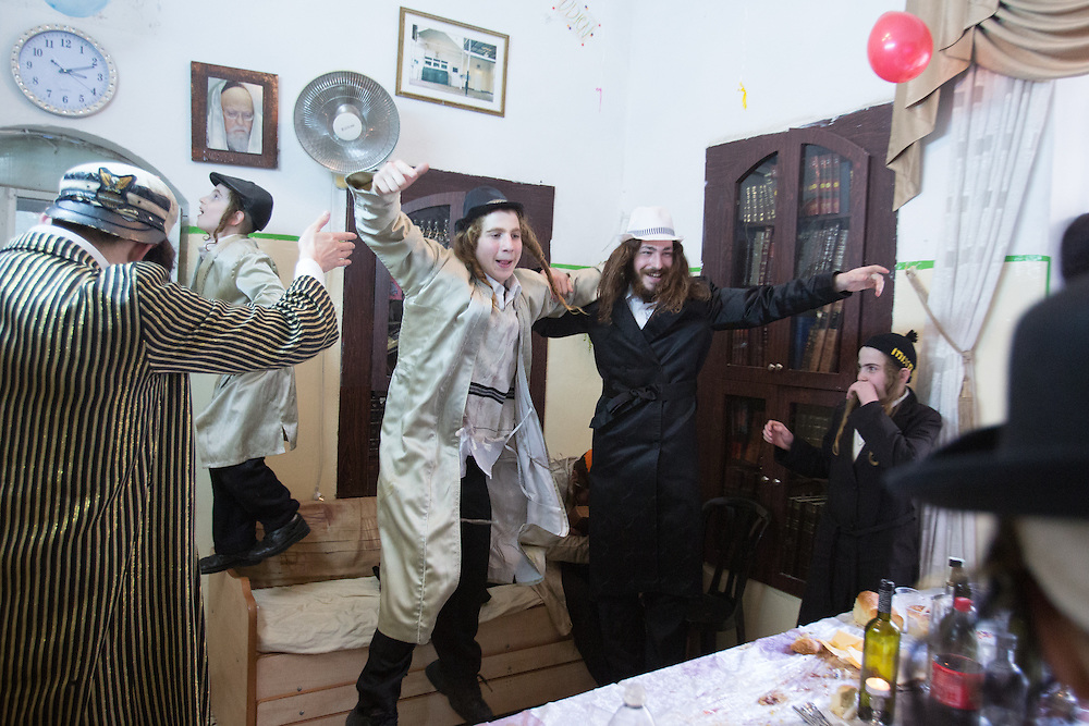 orthodox Jews dressed in costumes seen in the ultra orthodox neighborhood of Meah Shearim during the Jewish holiday of Purim. It is customary to dress up during Purim. Photo by Oren Nahshon.