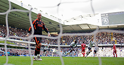 LONDON, ENGLAND - Sunday, September 18, 2011: Liverpool's goalkeeper Jose Reina looks dejected as Tottenham Hotspur's Luka Modric scores the first goal during the Premiership match at White Hart Lane. (Pic by David Rawcliffe/Propaganda)
