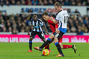 Newcastle United's Midfielder Siem de Jong and Liverpool's Midfielder Adam Lallana compete for the ball during the Barclays Premier League match between Newcastle United and Liverpool at St. James's Park, Newcastle, England on 6 December 2015. Photo by George Ledger.