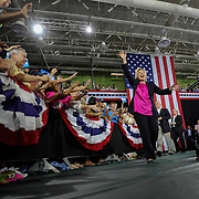 Democratic presidential candidate Hillary Clinton waves to supporters at a rally at the University of South Florida in Tampa, Fla., Tuesday, Sept. 6, 2016.